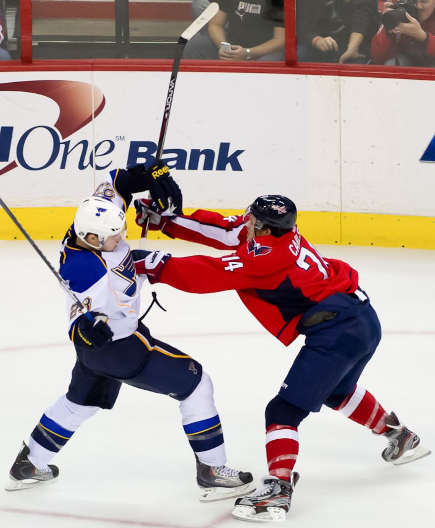Washington Capitals defenseman John Carlson (74) pushes St. Louis Blues defenseman Ian Cole (23) during the third period as the Washington Capitals take on the St. Louis Blues, Washington, DC, November 29, 2011. (Andrew Harnik/The Washington Times)