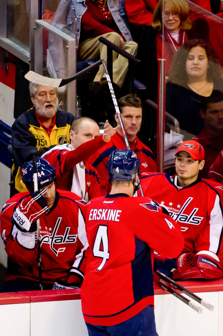 Washington Capitals defenseman John Erskine (4) trades in a broken hockey stick during a time out in the third period as the Washington Capitals take on the St. Louis Blues, Washington, DC, November 29, 2011. (Andrew Harnik/The Washington Times)