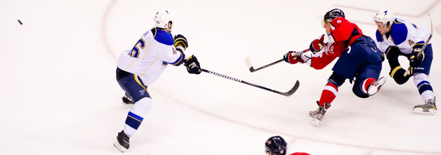 Washington Capitals left wing Alex Ovechkin (8) takes a shot on goal through St. Louis Blues defenseman Roman Polak (46) and St. Louis Blues defenseman Kris Russell (4) during the third period as the Washington Capitals take on the St. Louis Blues, Washington, DC, November 29, 2011. (Andrew Harnik/The Washington Times)