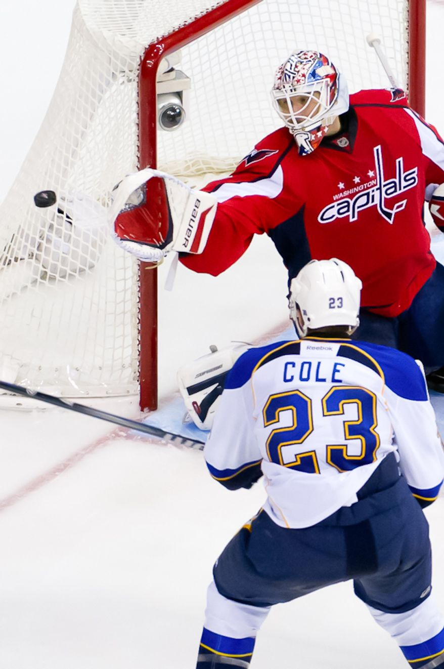 Washington Capitals goalie Tomas Vokoun (29) defects a shot on goal by St. Louis Blues defenseman Ian Cole (23) during the second period as the Washington Capitals take on the St. Louis Blues, Washington, DC, November 29, 2011. (Andrew Harnik/The Washington Times)