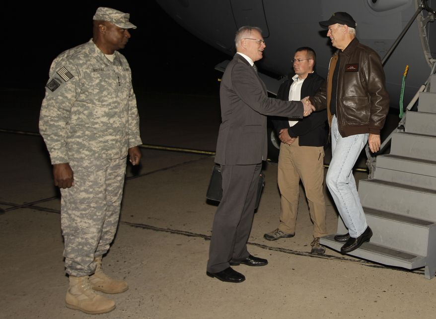 Gen. Lloyd Austin (left), the top U.S. commander in Iraq, looks on as Vice President Joseph R. Biden Jr. (right) shakes hands with the James Jeffrey, the U.S. ambassador to Iraq, upon Mr. Biden's arrival in Baghdad on Tuesday, Nov. 29, 2011. (AP Photo/Khalid Mohammed)