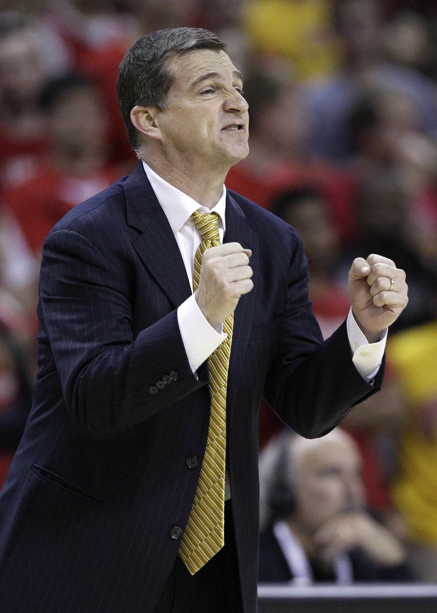 Maryland coach Mark Turgeon directs his players in the second half of an NCAA college basketball game against Illinois in College Park, Md., Tuesday, Nov. 29, 2011. Illinois won 71-62. (AP Photo/Patrick Semansky)