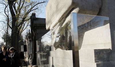 The renovated tombstone of Irish writer Oscar Wilde at the Pere Lachaise cemetery in Paris is now protected from kisses by a glass screen.