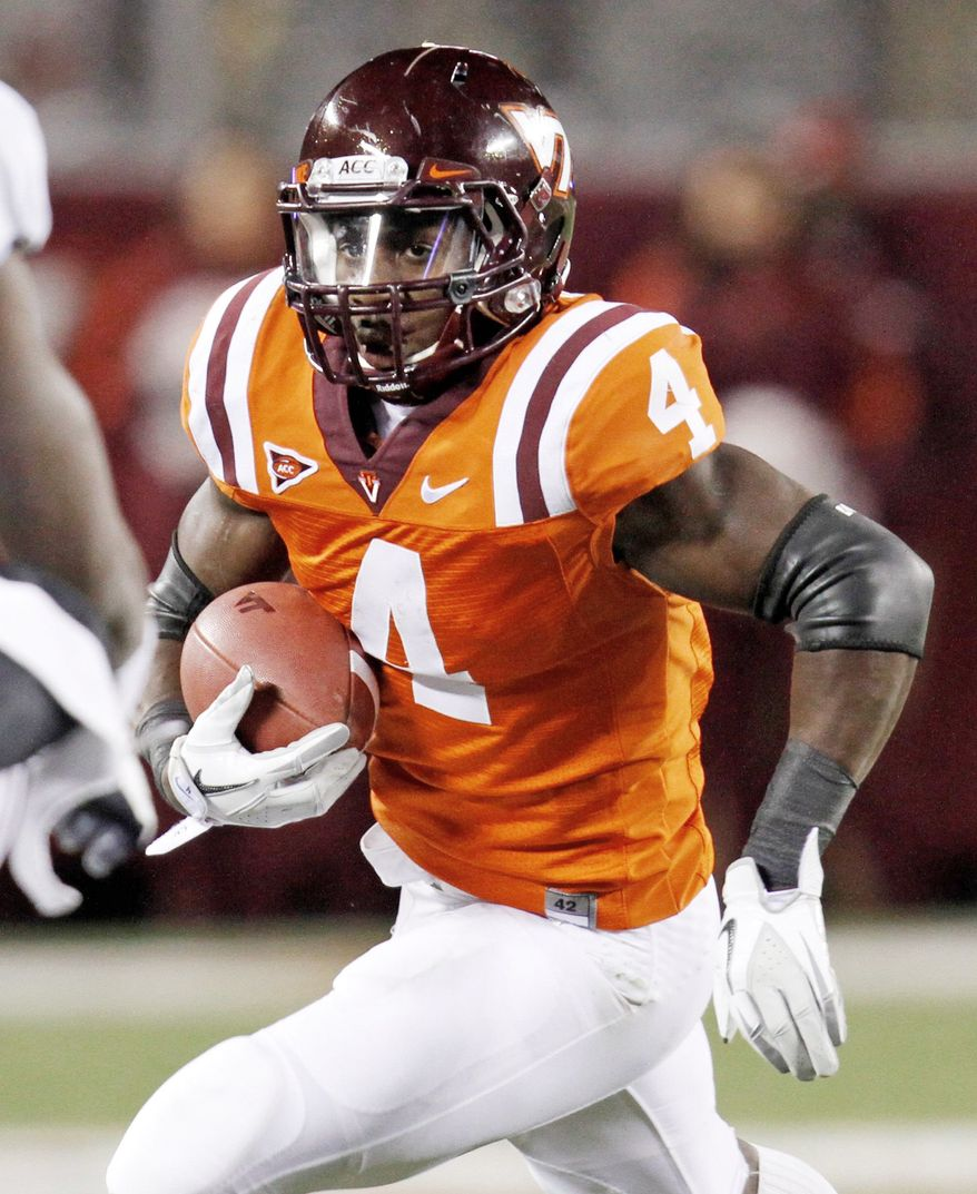 Virginia Tech's David Wilson was named ACC player of the year Wednesday. He had 1,595 yards rushing and nine touchdowns this season. (Associated Press)