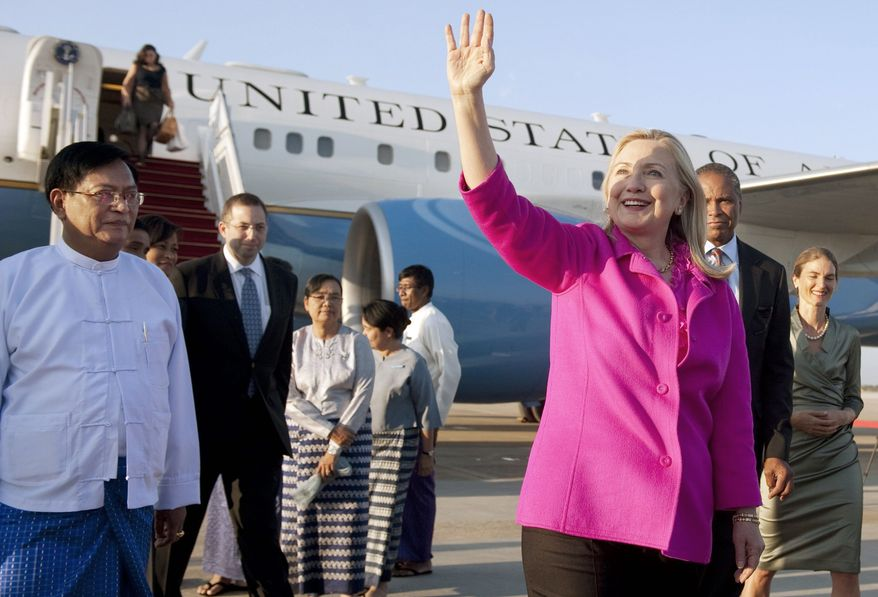 Secretary of State Hillary Rodham Clinton is greeted by Myanmar's Deputy Foreign Minister Myo Myint (left) upon her arrival Wednesday in Naypyidaw. It is the first trip to the Southeast Asian nation by a secretary of state in more than 50 years. (Associated Press)