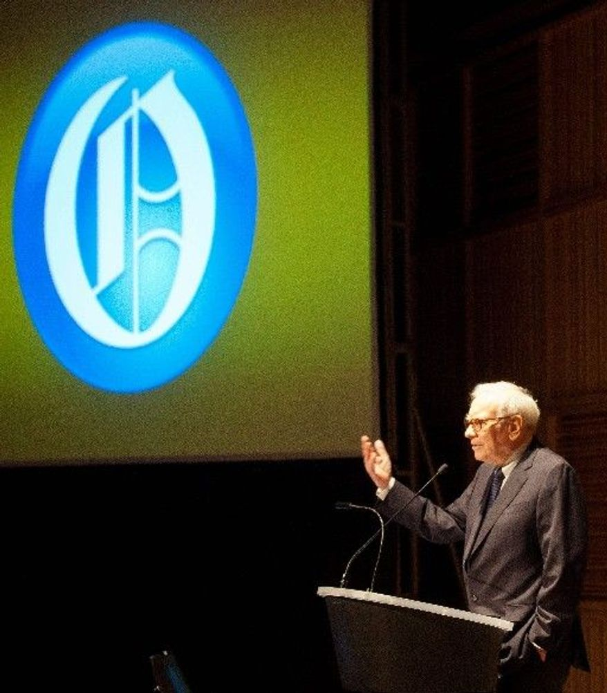 Warren Buffett, chairman of Berkshire Hathaway Inc., speaks Wednesday about the purchase of the Omaha World-Herald newspaper by the holding company. The deal requires approval of the World-Herald's shareholders. (Omaha World-Herald via Associated Press)
