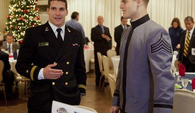 Navy fullback Alexander Teich, left, and Army linebacker Steve Erzinger talk during the Army- Navy football game luncheon on Wednesday, Nov. 30, 2011 in Arlington, Va. (AP Photo/Evan Vucci)