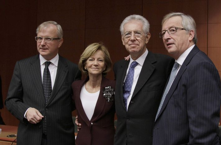 From left, European Commissioner for the Economy Olli Rehn, Spain's Finance Minister Elena Salgado, Italian Prime Minister and Finance Minister Mario Monti and Luxembourg's Prime Minister Jean-Claude Juncker pose for a photo during a round table meeting of the eurogroup at the EU Council building in Brussels on Tuesday, Nov. 29, 2011. (AP Photo/Virginia Mayo)