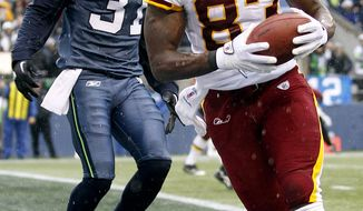 **FILE** Washington Redskins tight end Fred Davis (right) runs past the Seattle Seahawks' Kam Chancellor after catching a pass for a touchdown in the first quarter the Redskins' 23-17 road win on Nov. 27, 2011. (Associated Press)