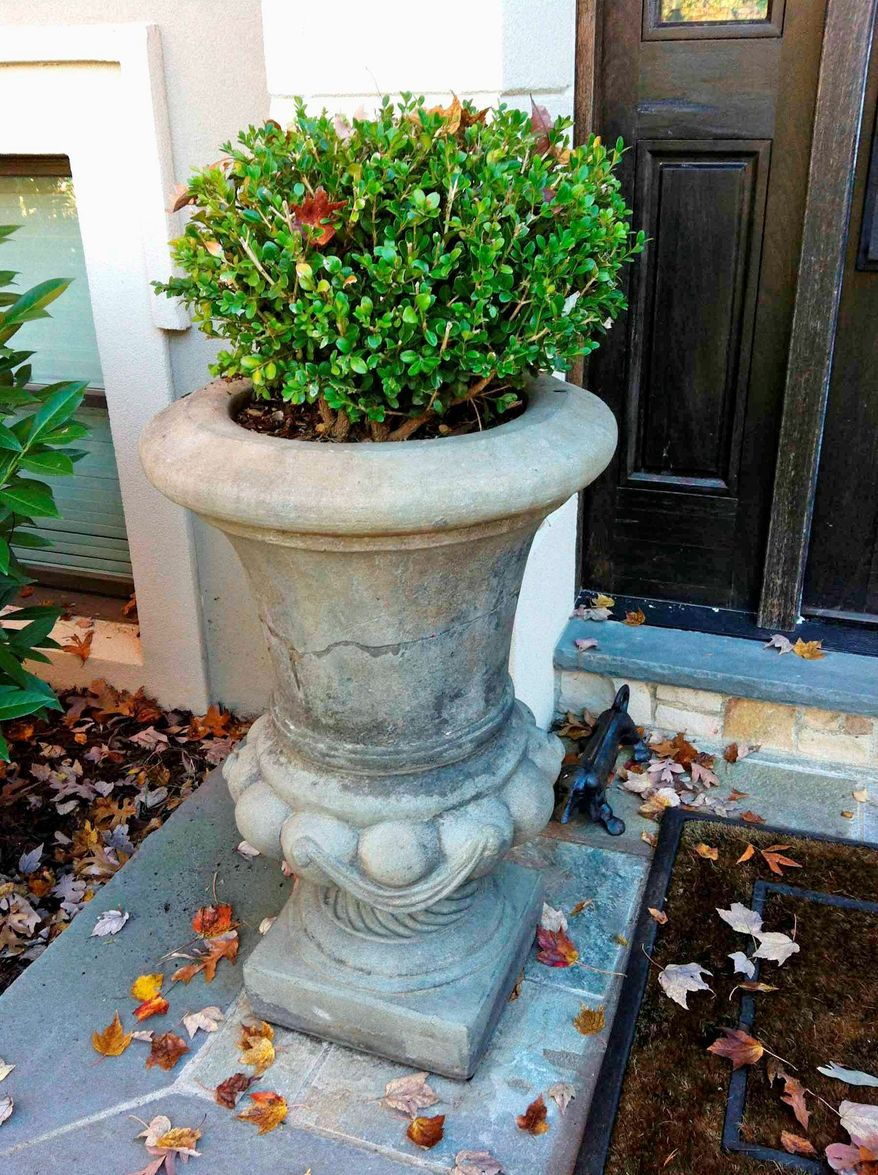 Jeff Akseizer with McLean's Akseizer Design Group suggests a distinctive door knocker or an urn to give a home some instant curb appeal.
