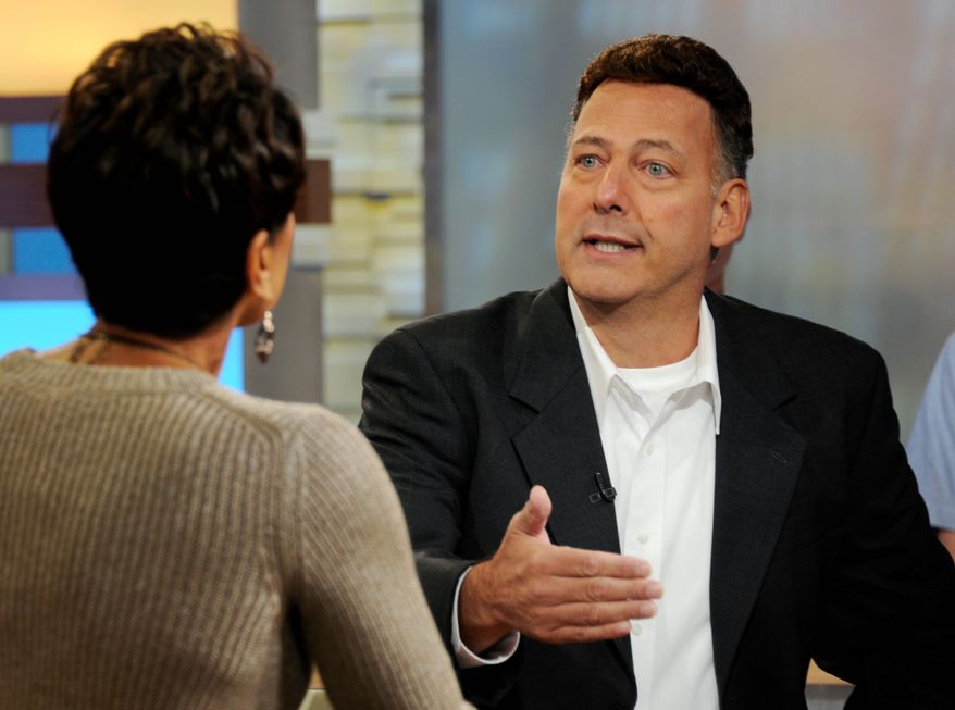 """Gary Giordano, right, of Gaithersburg, who was detained for four months after the presumed death of his traveling companion, Robyn Gardner, in Aruba, is interviewed by Robin Roberts on ABC television's """"Good Morning America"""" in New York, Thursday, Dec. 1, 2011.(AP Photo/Ida Mae Astute, ABC)"""