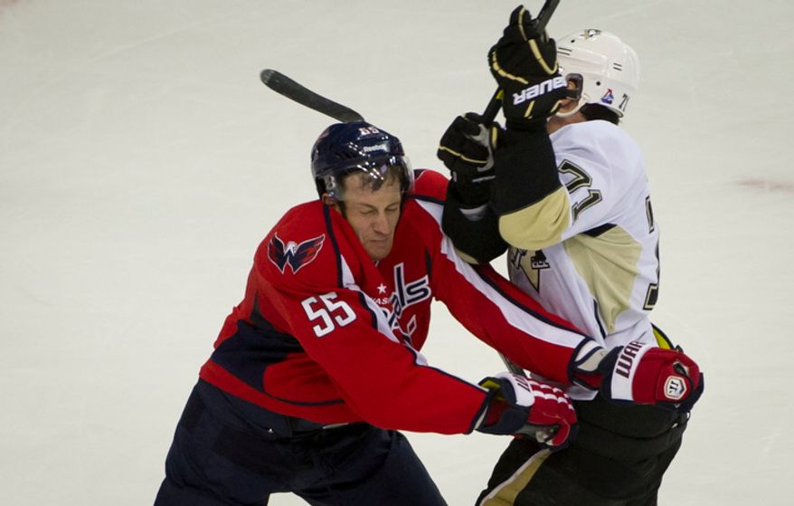 Capitals Jeff Schultz (55) collides on the ice with Penguins Evgeni Malkin (71) in the second period as the Washington Capitals host the Pittsburg Penguins at the Verizon Center in Washington, DC, Thursday, December 1, 2011. (Rod Lamkey Jr/ The Washington Times)