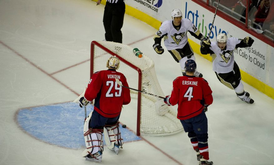 Capitals Tomas Vokoun (29) and John Erskine (4) watch as the Penguins score their second goal and winning goal in the third period as the Washington Capitals host the Pittsburg Penguins at the Verizon Center in Washington, DC, Thursday, December 1, 2011. The Penguins won 2-1. (Rod Lamkey Jr/ The Washington Times)