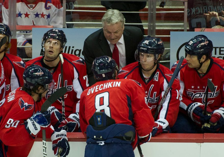 Capitals Head Coach Dale Hunter has a word with his captain Alex Ovechkin (8) in the third period as the Washington Capitals host the Pittsburg Penguins at the Verizon Center in Washington, DC, Thursday, December 1, 2011. The Penguins won 2-1. (Rod Lamkey Jr/ The Washington Times)