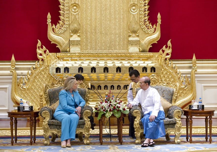 Myanmar President Thein Sein (right) meets with U.S. Secretary of State Hillary Rodham Clinton at the President's Office in Naypyidaw, Myanmar, on Thursday, Dec. 1, 2011. (AP Photo/Saul Loeb, Pool)