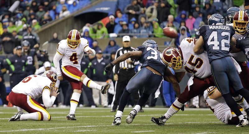 The Seattle Seahawks defense blocks a field goal attempt by Washington Redskins kicker Graham Gano (4) in the first half of an NFL football game, Sunday, Nov. 27, 2011, in Seattle. (AP Photo/Ted S. Warren)