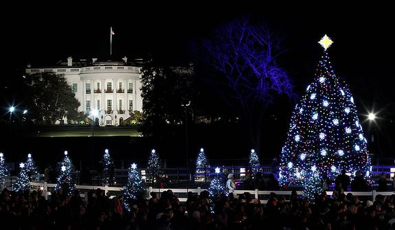 The National Christmas Tree is pictured with the White House in the background after it was lit on the Ellipse across from the White House in Washington, Thursday, Dec., 1, 2011. (AP Photo/Pablo Martinez Monsivais)