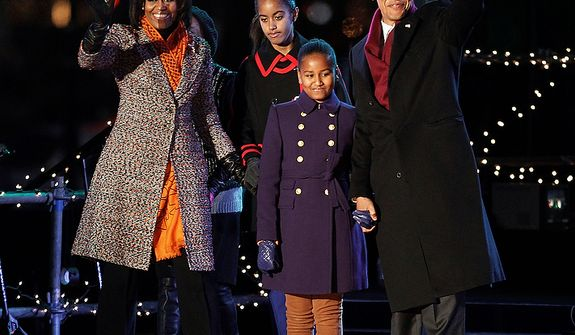 President Barack Obama, first lady Michelle Obama, and daughters Malia and Sasha Obama arrive for lighting of the National Christmas Tree on the Ellipse across from the White House in Washington, Thursday, Dec., 1, 2011. (AP Photo/Pablo Martinez Monsivais)
