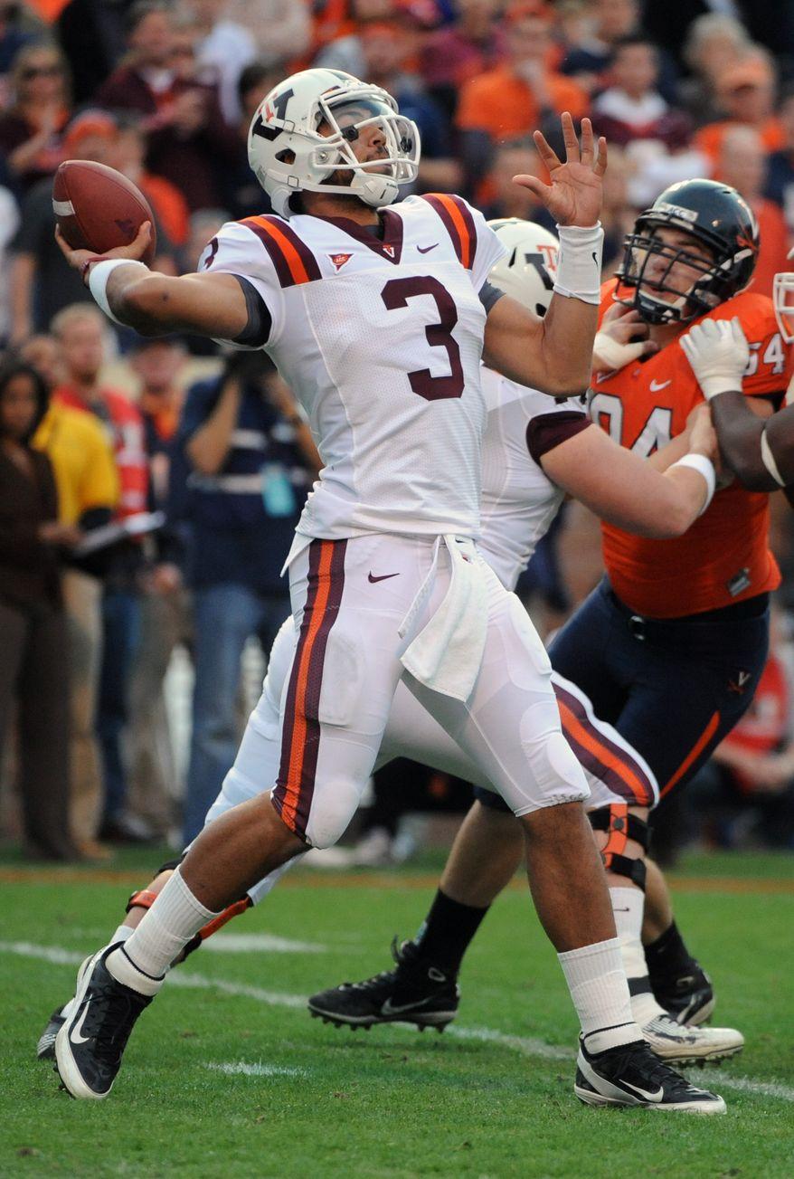 Virginia Tech's quarterback Logan Thomas passes against Virginia during first half, Saturday Nov. 26, 2011 at Scott Stadium in Charlottesville, Va. (AP Photo/Don Petersen)