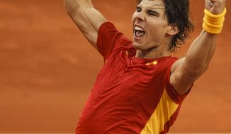 Spain's Rafael Nadal celebrates defeating Argentina's Juan Monaco after the first match of the Davis Cup Final, in Sevilla, Spain, Friday, Dec. 2, 2011. (AP Photo/Daniel Ochoa de Olza)