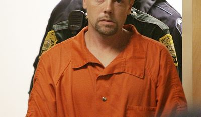 ** FILE ** In this Nov. 10, 2010, file photo, Christopher Smeltzer arrives for arraignment in District Court in Candia, N.H., on a charge he beat his wife to death. (AP Photo/Jim Cole, File)