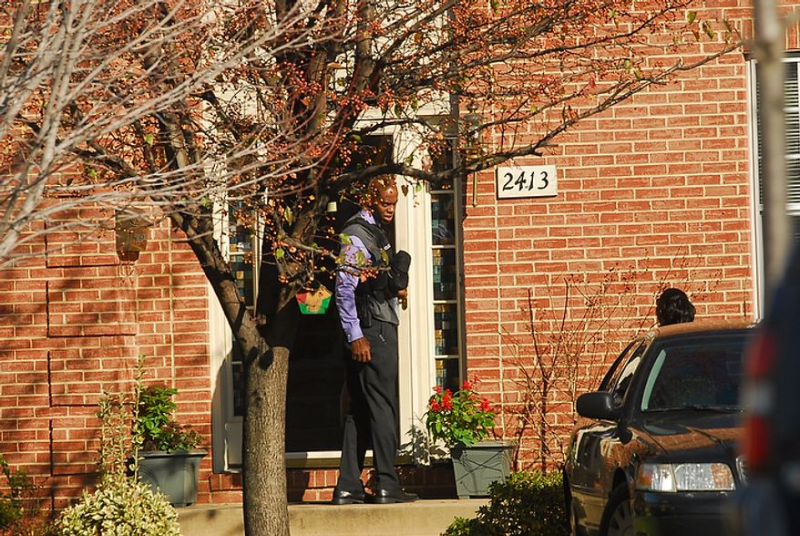 FBI and IRS Criminal Investigative Division agents serve a search warrant on the home of Washington D.C. City Council member Harry Thomas, Jr., on 17th Street NE in Washington, D.C., on Friday, December 2, 2011. (Pratik Shah./The Washington Times)