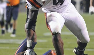 Virginia Tech running back David Wilson breaks the tackle of Virginia safety Corey Mosley for a touchdown during the first half at Scott Stadium in Charlottesville, Va. Saturday Nov. 26, 2011. (AP Photo Don Petersen)