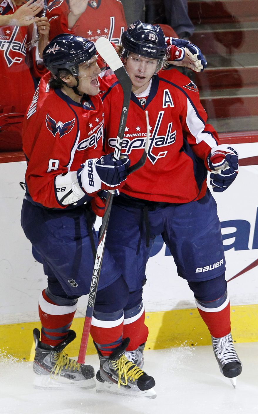 Washington Capitals left wing Alex Ovechkin (8), of Russia, congratulates teammate Nicklas Backstrom, right, of Sweden, after Backstrom scored on Ottawa Senators goalie Craig Anderson (41) during the first period of an NHL hockey game in Washington, Saturday, Dec. 3, 2011. (AP Photo/Ann Heisenfelt)