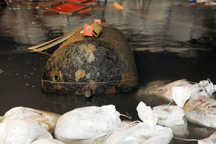 A defused World War II bomb sits the Rhine River near Koblenz, Germany. The massive British bomb that triggered the evacuation of about half of the 107,000 residents of Germany's western city of Koblenz was defused Sunday, authorities said. (Associated Press)