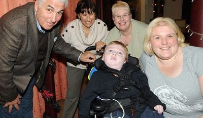Amy Winehouse's parents, Mitch and Janis (second from left) Winehouse, meet Callum Miller; his mother, Jane Morgan; and grandmother, Victoria Morgan, at a children's hospice that received a grant from the Amy Winehouse Foundation. (The Amy Winehouse Foundation via Associated Press)