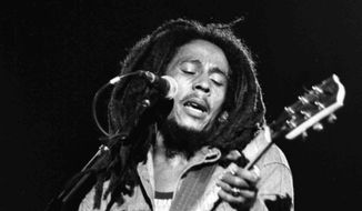 Bob Marley performs at a reggae festival in Paris in 1980. (Associated Press) ** FILE **