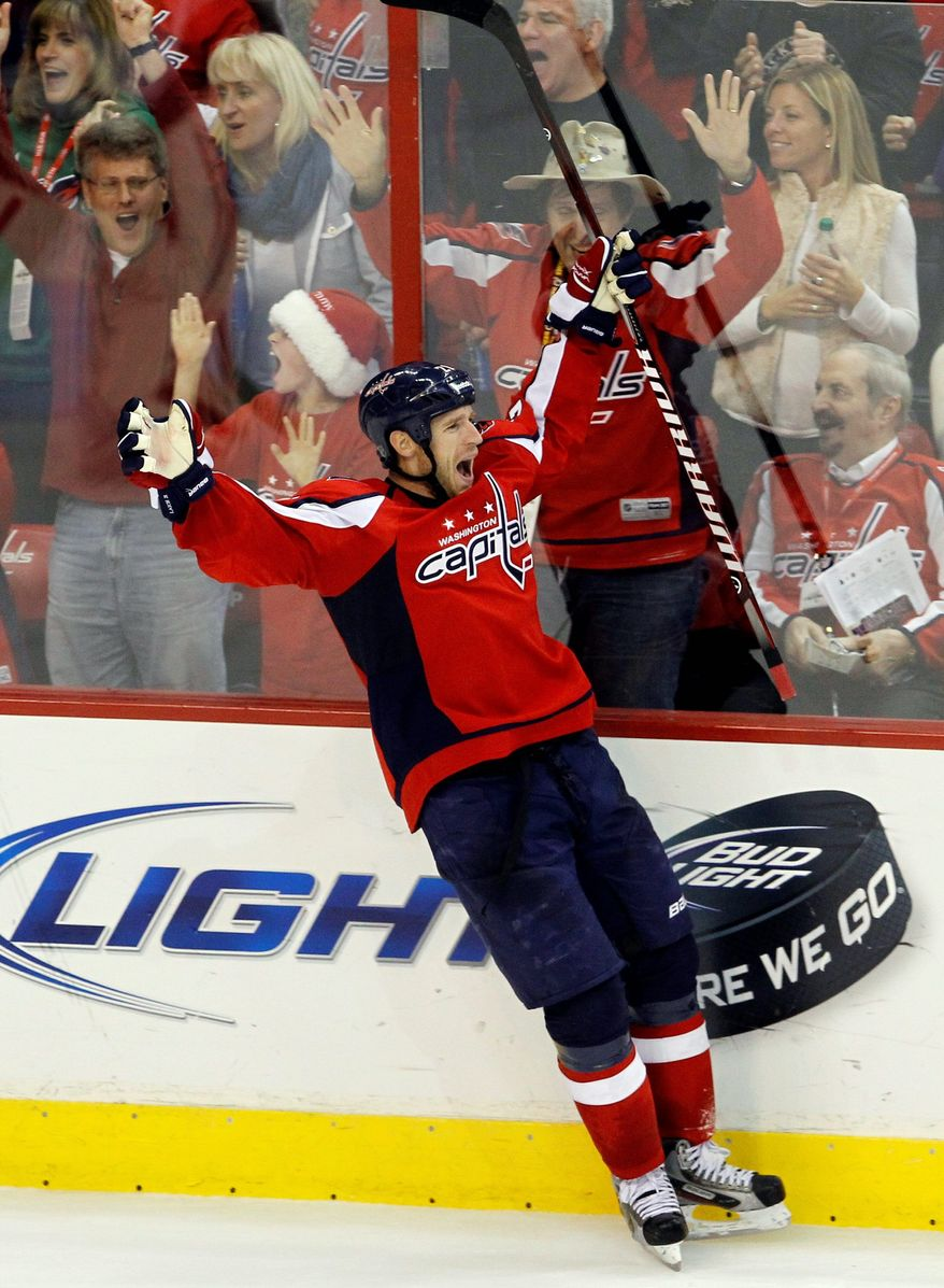 ASSOCIATED PRESS Capitals center Brooks Laich celebrates his game-winning goal Saturday in Washington's 3-2 overtime win over Ottowa at Verizon Center. It was the first win since Dale Hunter took over as coach last week.