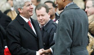 "Detroit Mayor Dave Bing (right), greeting Michigan Gov. Rick Snyder at his Jan. 1 inauguration, does not agree with the governor's idea of a state takeover of his troubled city. ""We know what needs to be done, and we stand ready to do it,"" Mr. Bing said. (Associated Press)"