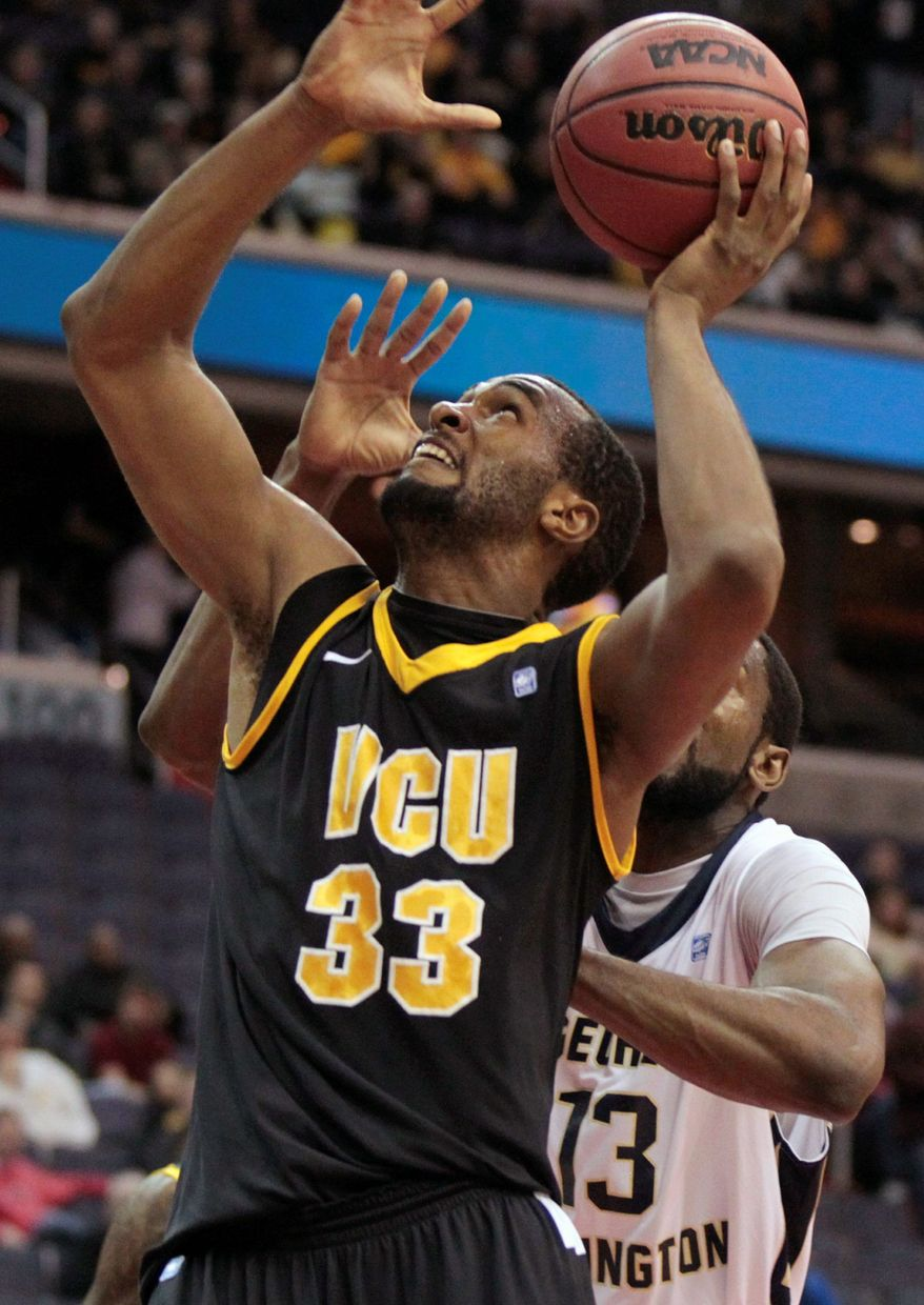 Virginia Commonwealth's D.J. Haley shoots in front of George Washington's Jabari Edwards during the first half of the BB&T Classic in Washington, Sunday, Dec. 4, 2011. (AP Photo/Luis M. Alvarez)