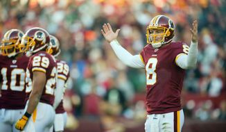 Quarterback Rex Grossman will have his hands full trying to lead the 4-8 Redskins to another win this season. (Pratik Shah/The Washington Times)