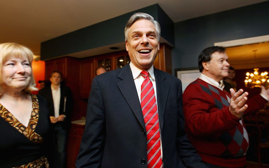 Republican presidential candidate Jon Huntsman Jr. arrives at a house party hosted Thursday by Don and Melinde Byrne in Bedford, N.H. Mr. Huntsman has written off Iowa, and has spent neither time nor money campaigning there. (Associated Press)