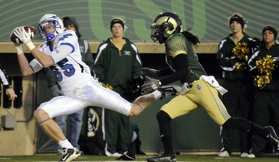 Air Force wide receiver Zack Kauth, left, catches a touchdown pass from Tim Jefferson Jr. in the second quarter of an NCAA college football game in Fort Collins, Colo., Saturday, Nov. 26, 2011. Air Force won 45-21. (AP Photo/The Denver Post, Hyoung Chang)