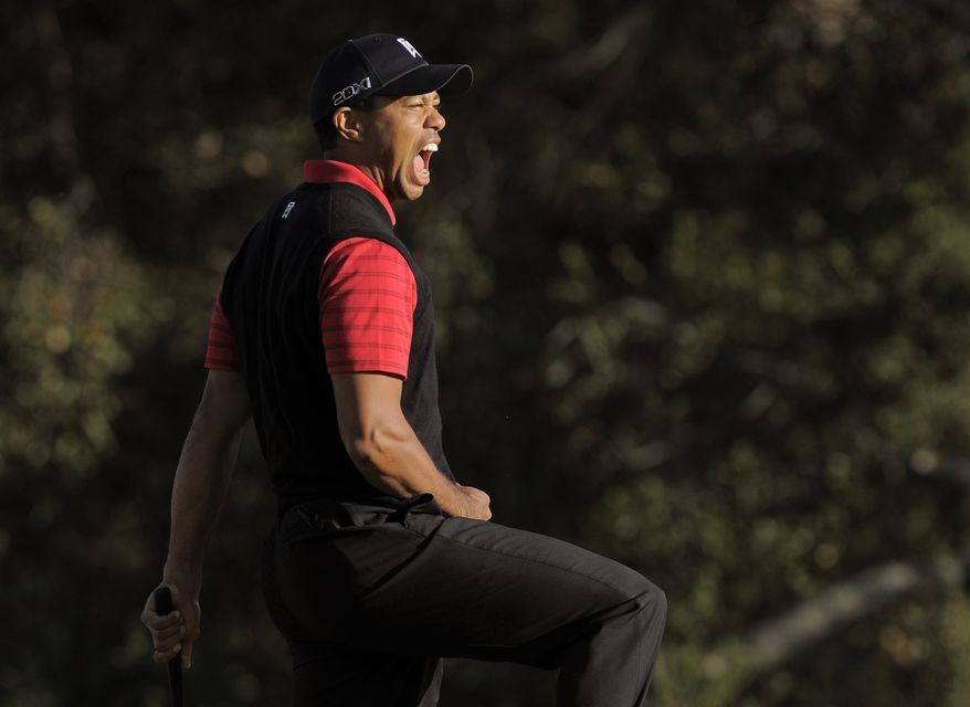 Tiger Woods reacts after winning the Chevron World Challenge golf tournament at Sherwood Country Club, Sunday, Dec. 4, 2011, in Thousand Oaks, Calif. Woods closed with clutch birdie putts, including holing a 6-foot birdie putt on the 18th hole for a 3-under 69, to win by one shot over former Masters champion Zach Johnson. (AP Photo/Mark J. Terrill)
