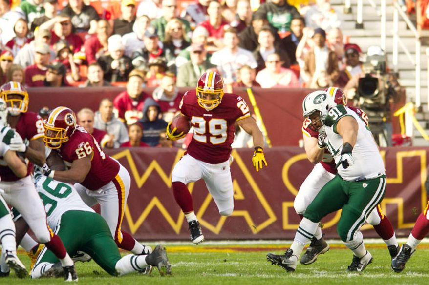 Washington Redskins running back Roy Helu (29) runs for a 15 yard gain to start the game. (Andrew Harnik/The Washington Times)