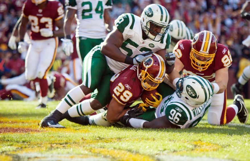 Washington Redskins running back Roy Helu (29) runs the ball in for a touchdown during the first quarter of the game against the New York Jets. (Pratik Shah/The Washington Times)