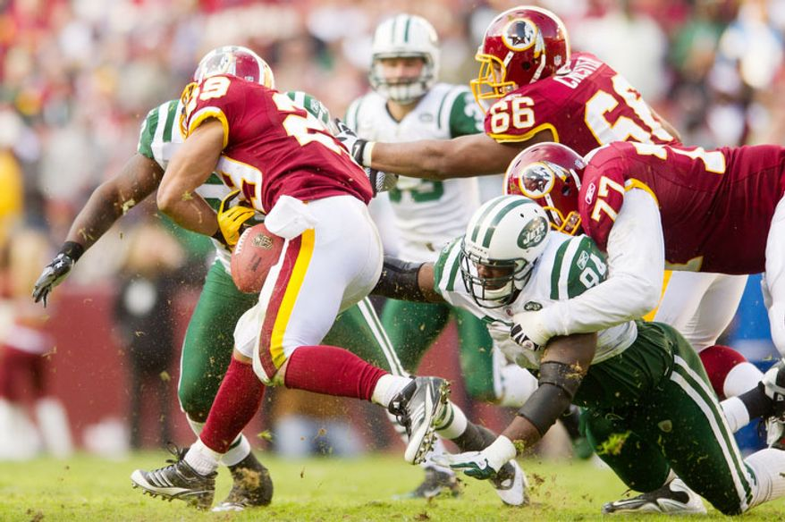Washington Redskins running back Roy Helu (29) fumbles on a 4 yard gain in the third quarter. (Andrew Harnik/The Washington Times)