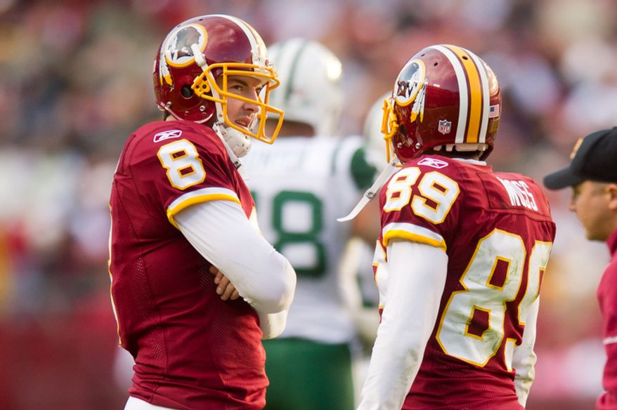 Washington Redskins quarterback Rex Grossman (8) and Washington Redskins wide receiver Santana Moss (89) talk on the field during a challenge on a fumble by Washington Redskins running back Roy Helu (29) in the third quarter. (Andrew Harnik/The Washington Times)