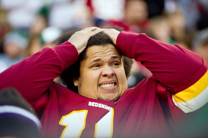 Redskins fan Julian Bradley of Wisconsin shows his frustration in the fourth quarter. (Andrew Harnik/The Washington Times)
