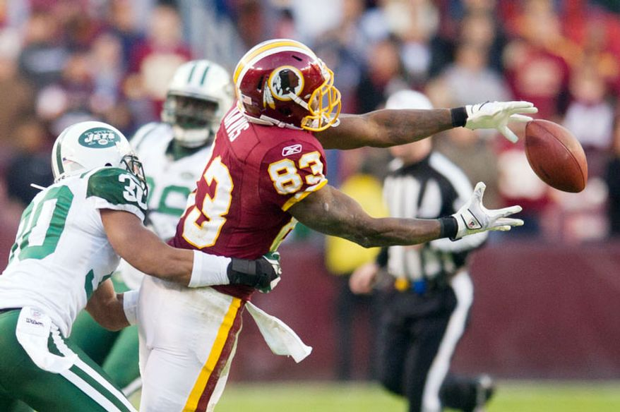 Washington Redskins tight end Fred Davis (83) drops a pass in the fourth quarter. (Andrew Harnik/The Washington Times)