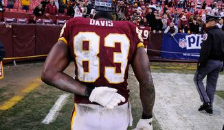 Washington Redskins tight end Fred Davis (83) walks off the field after a 34-19 loss to the Jets. Davis will serve a four-game suspension following the game at FedEx Field in Landover, Md., on Sunday, December 4, 2011. (Preston Keres/For The Washington Times)