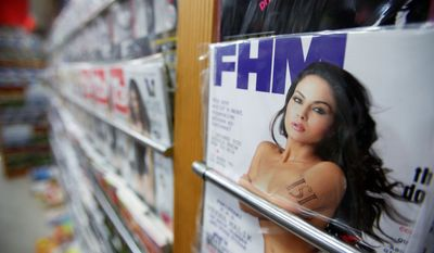 The photo on the cover of the December edition of FHM India, a lifestyle magazine, shows Pakistani actress Veena Malik with ISI, representing Pakistan's spy agency, tattooed on her left arm (top). Miss Malik (above) says photos in the magazine were doctored to make her appear to be nude. (Associated Press)
