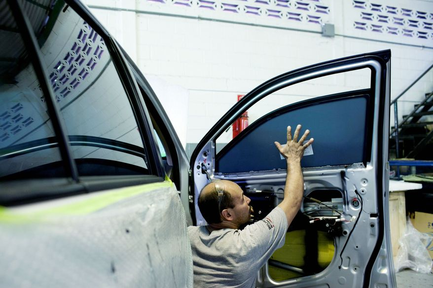 An armored car with bullet-resistant windows is under assembly at a plant in Cagua, Venezuela. (Associated Press)
