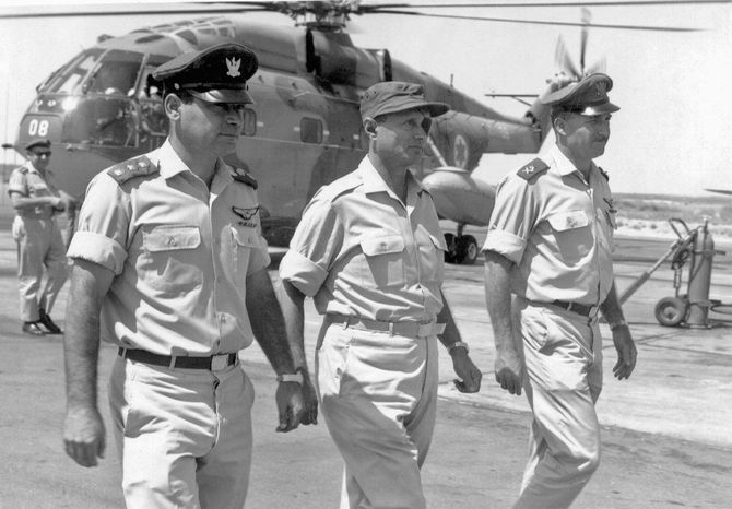 Col. Joseph Alon (left) was an ace fighter pilot in Israel. He is shown here in 1969 with Israeli Defense Minister Moshe Dayan (center) and Mordechai Hod, commander of the Israeli air force. (Alon family via Associated Press)
