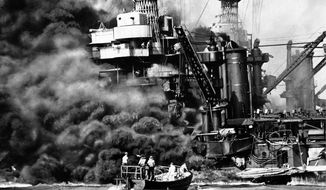 "FILE - In this Dec. 7, 1941 file photo provided by the U.S. Navy, a Navy launch pulls up to the blazing USS West Virginia to rescue a sailor during the attack on Pearl Harbor. An excavation crew recently made a startling discovery at the bottom of Pearl Harbor when it unearthed a skull that archeologists suspect is from a Japanese pilot who died in the historic attack. Archaeologist Jeff Fong of the Naval Facilities Engineering Command Pacific described the discovery to The Associated Press and the efforts under way to identify the skull. He said the early analysis has made him ""75 percent sure"" that the skull belongs to a Japanese pilot. (AP Photo/U.S. Navy, file)"