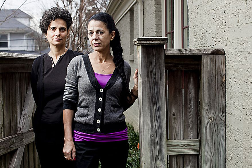 Rachel Alon-Margalit (left) and her older sister Yael Alon-Rosenshain, daughters of Israeli air force military attache Joseph Alon, who was killed outside their Chevy Chase home in 1973, are pictured at the home of a friend as they prepare for the screening of a documentary on the case. (T.J. Kirkpatrick/The Washington Times)